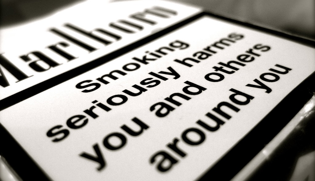 Warning Labels for Cigarettes, Alcohol and Junk Food: Is There Any Point?
